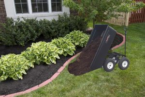 dump cart pouring mulch on yard