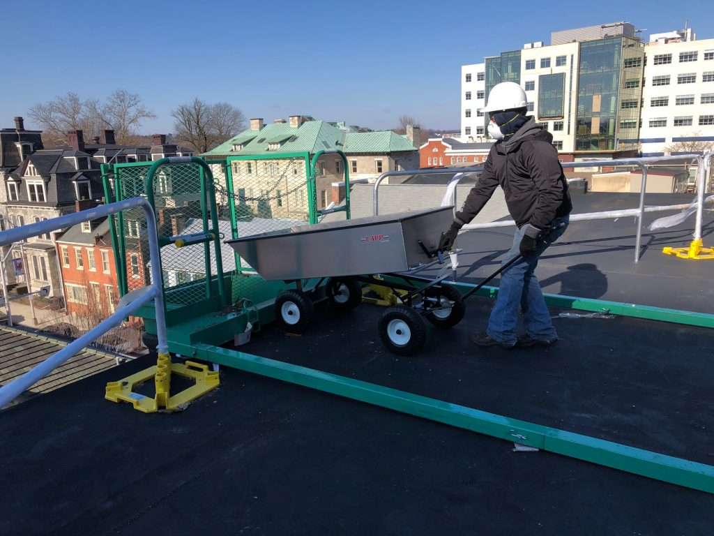 commercial roofing cart being dumped 1
