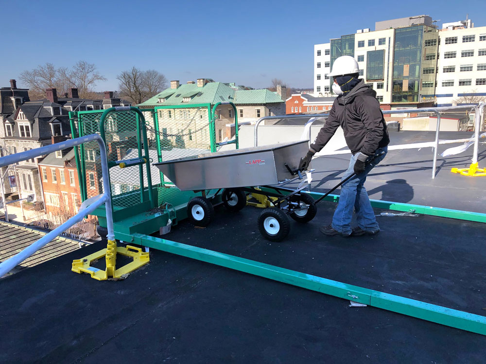 commercial roofing cart being dumped 3