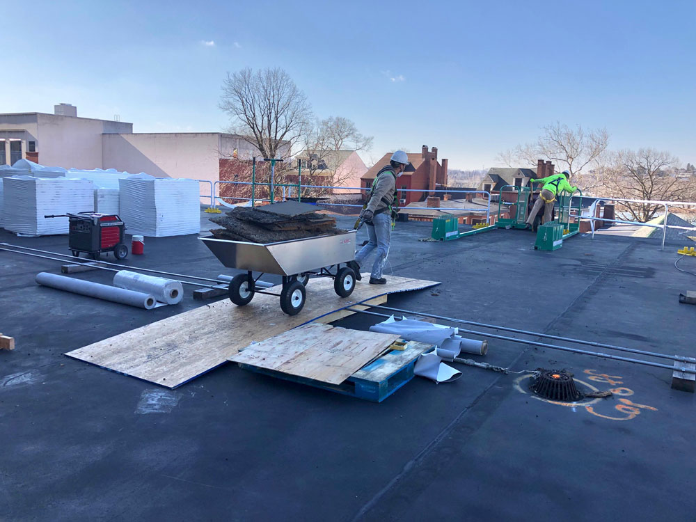 commercial roofing cart being pulled 1