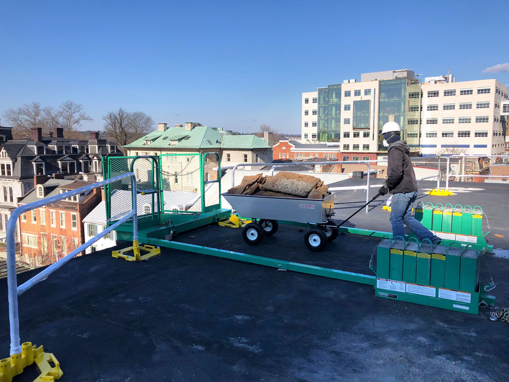 commercial roofing cart being pushed 1